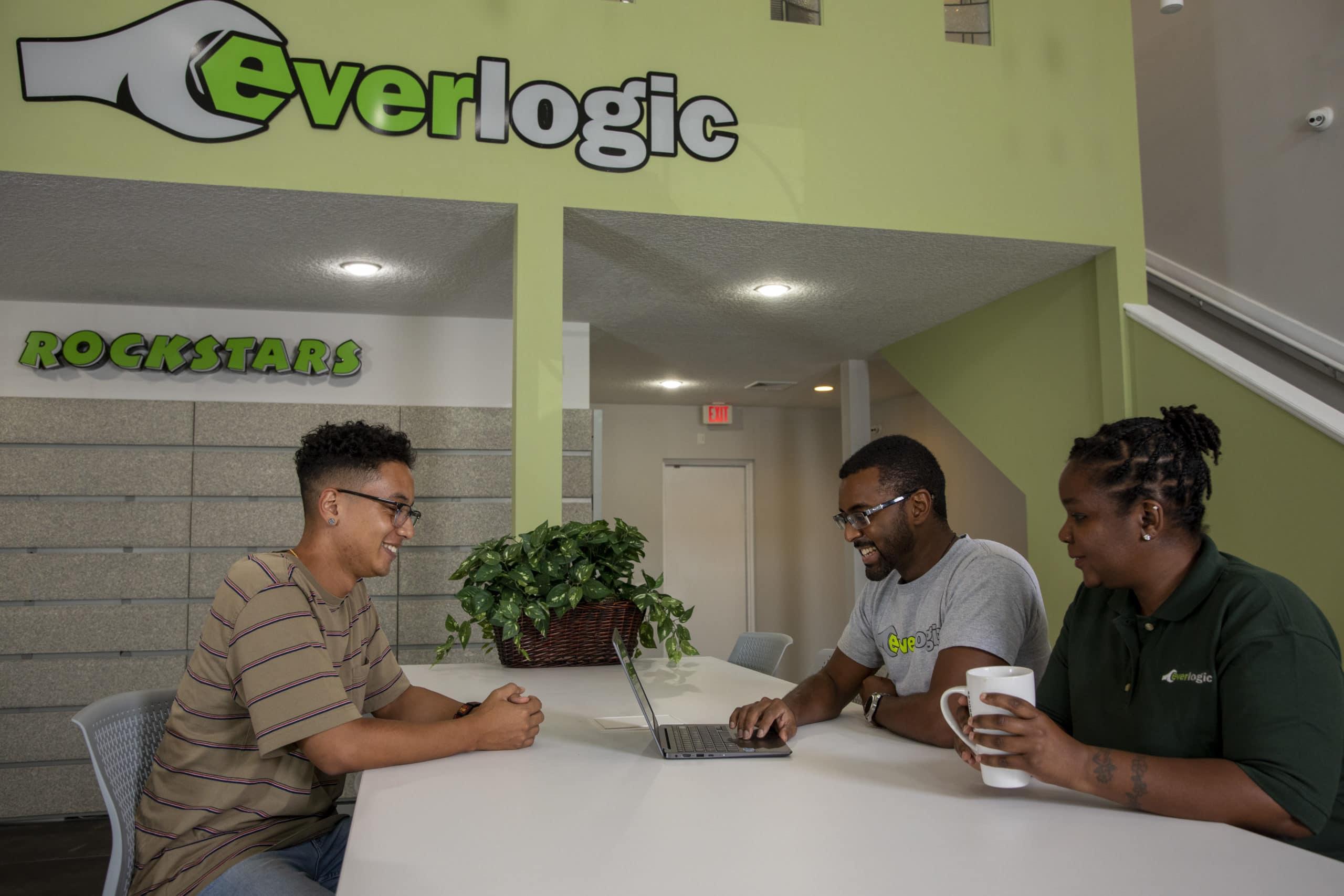 Everlogic Team Around Computer At Table