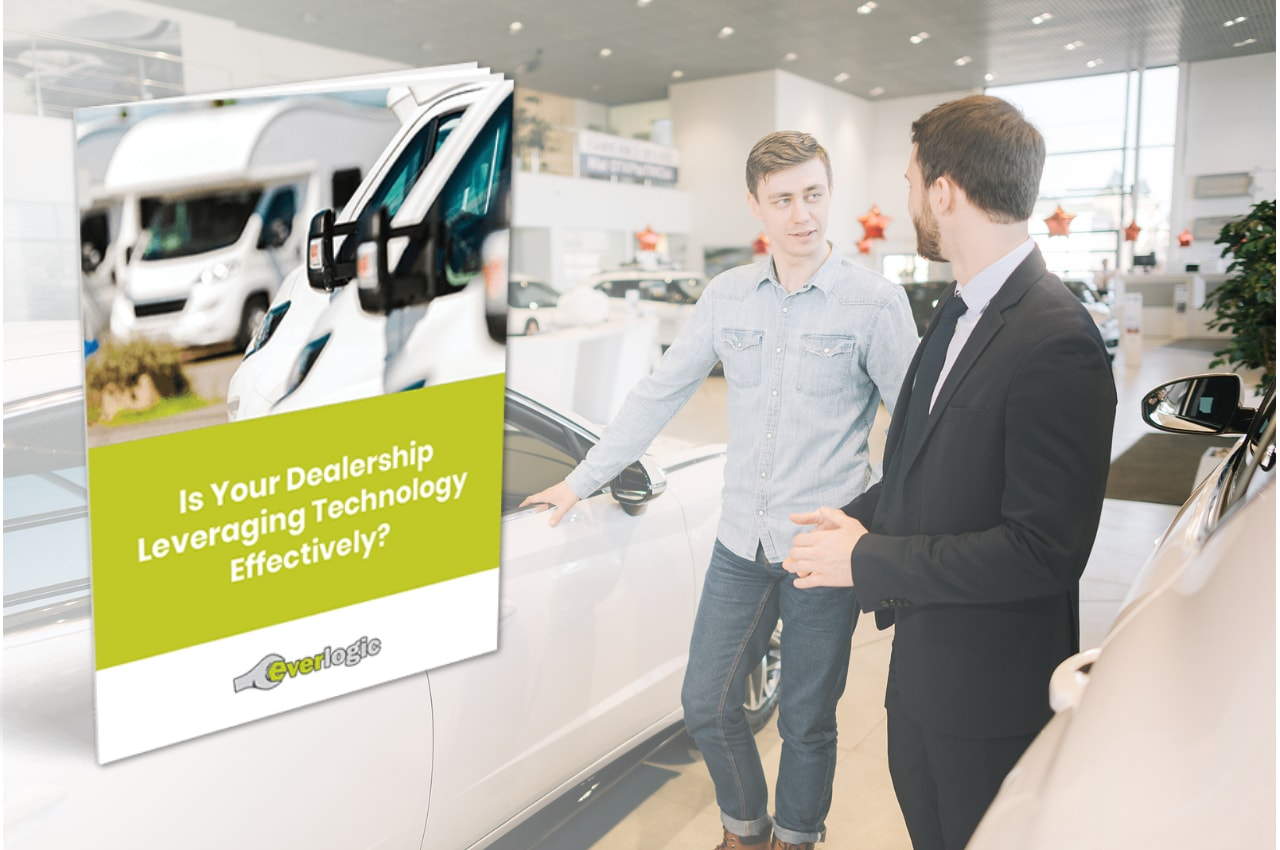 A Salesman And Customer Are Standing Next To A Car. An Image Of A Pamphlet Reads